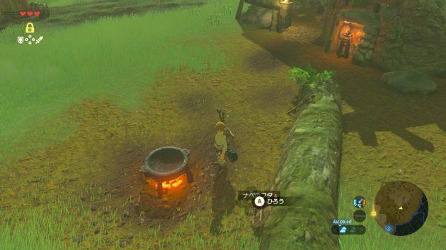 老人の家の前のたき火と鍋