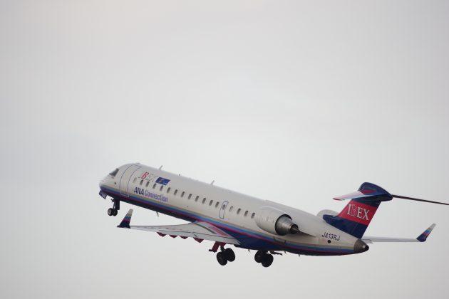 離陸後の飛行機のお尻写真